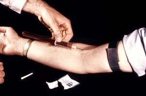Clinician shown here is obtaining a blood sample